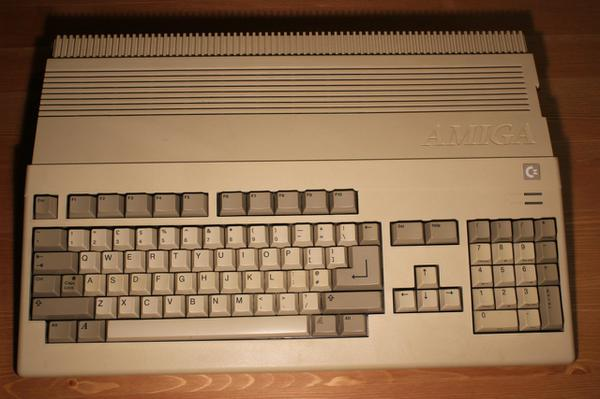 A beige integrated keyboard old looking computer