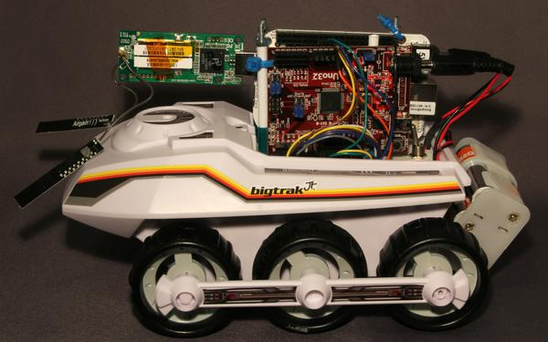 View of the modified BigTrak robot with BeagleBone and ChipKit mounted on the back.