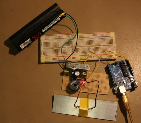 The regulator set up with a power resistor and Arduino to check the battery shuts off properly.