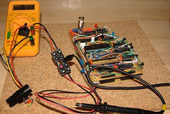 A board hooked up to the multimeter to measure current.